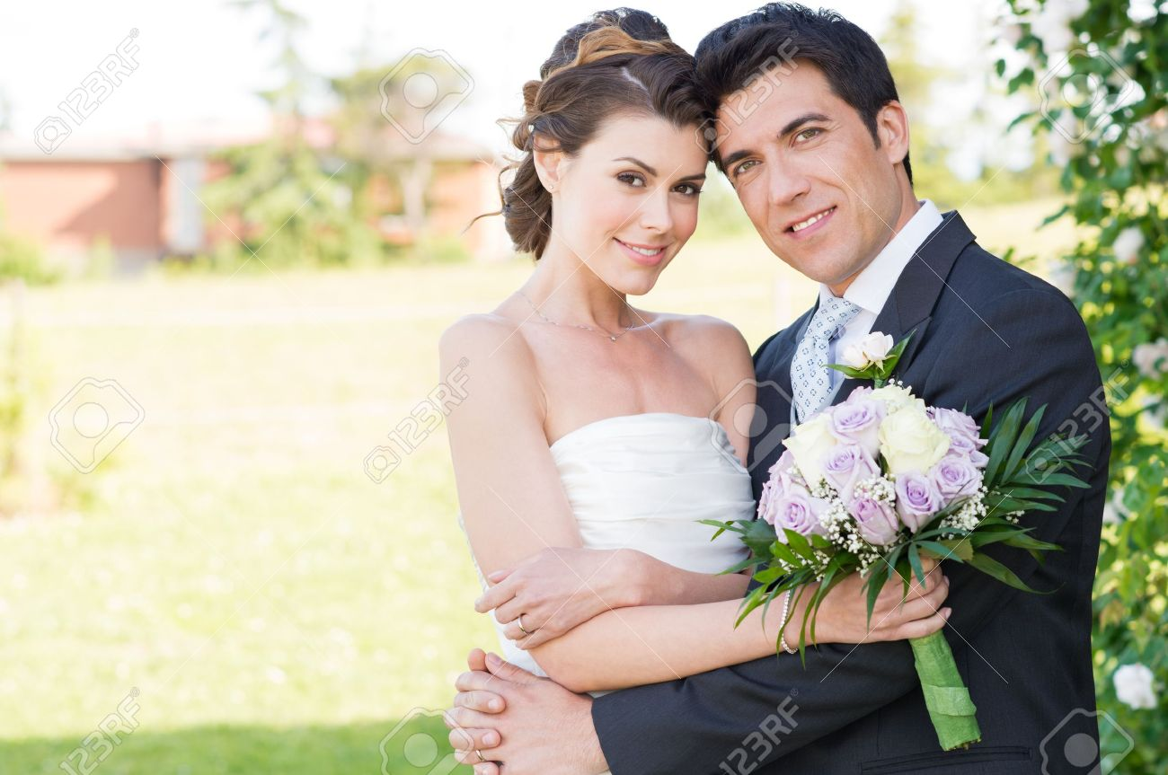 Portrait Of Happy Beautiful Young Married Couple - 20838012