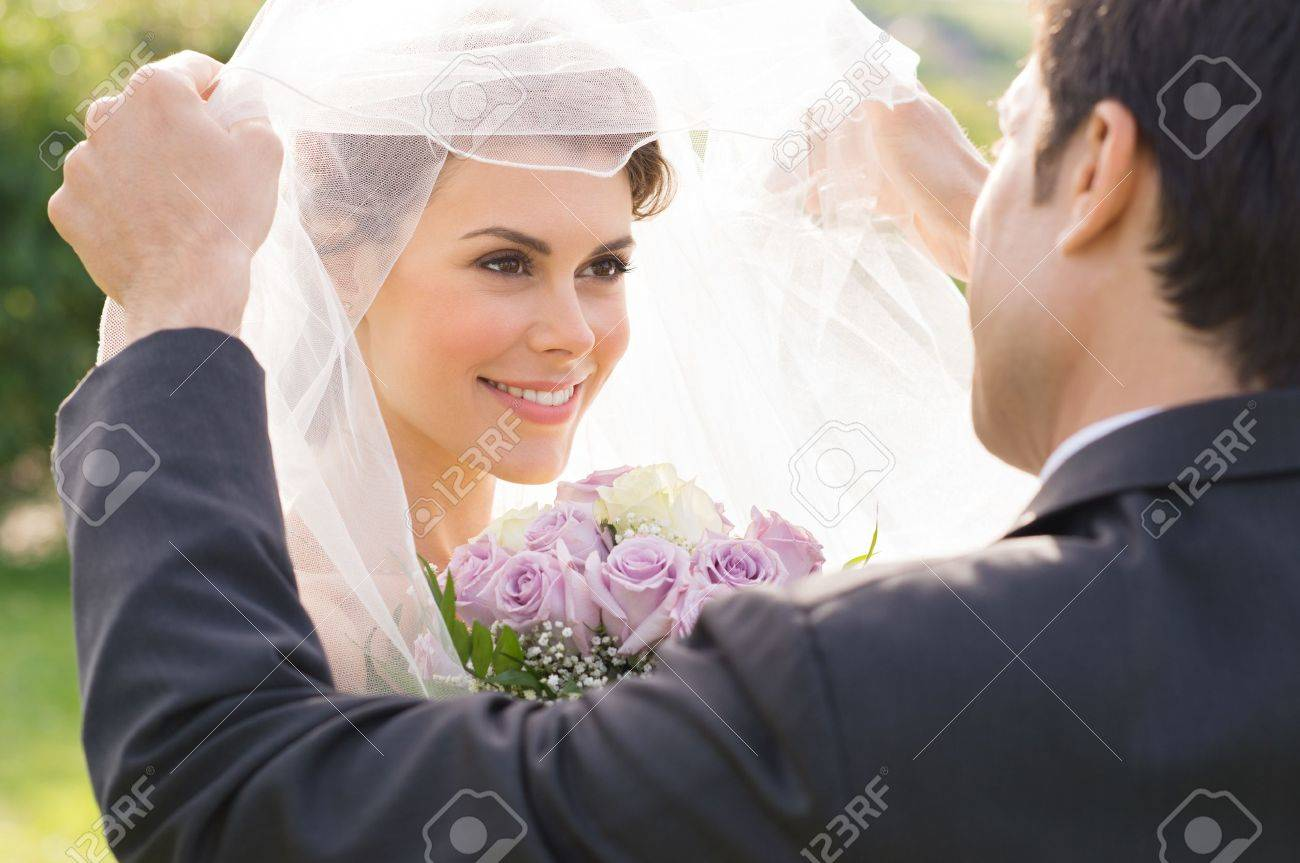 Closeup Of Groom Looking At Bride During the Wedding Ceremony - 20838028