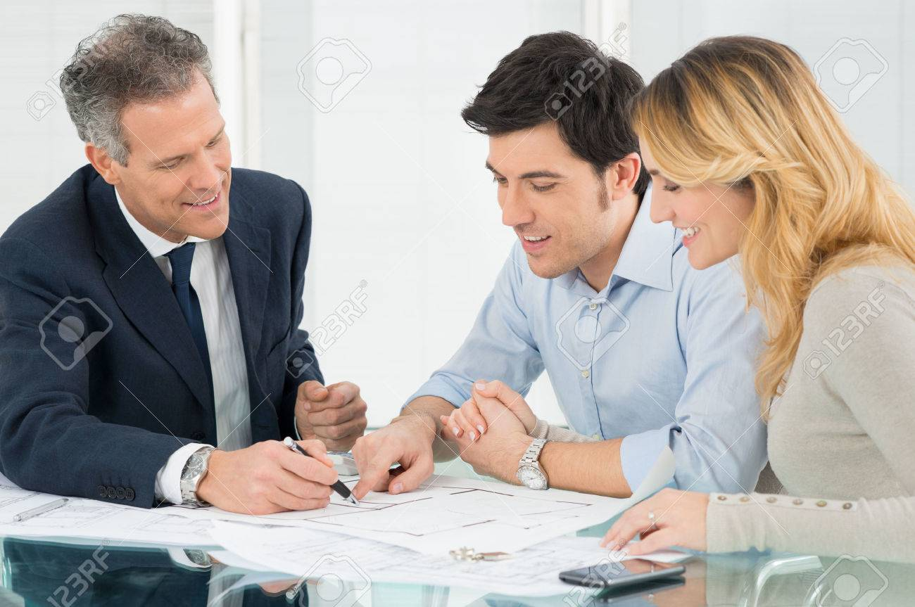 Happy Couple Looking Blueprint About New House Stock Photo - 27613902