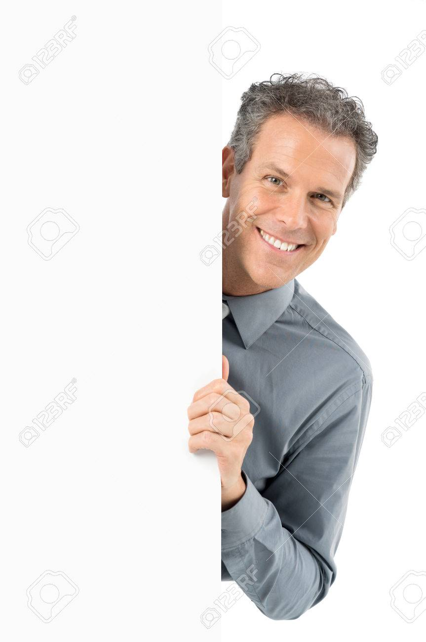 Portrait Of Mature Businessman Holding Blank Billboard Looking At Camera Isolated On White Background Stock Photo - 27614201