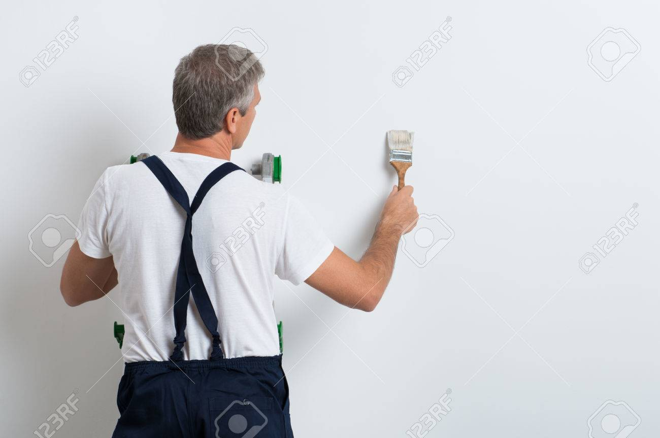 Painter On Stepladder Painting Wall With Brush - 33251425