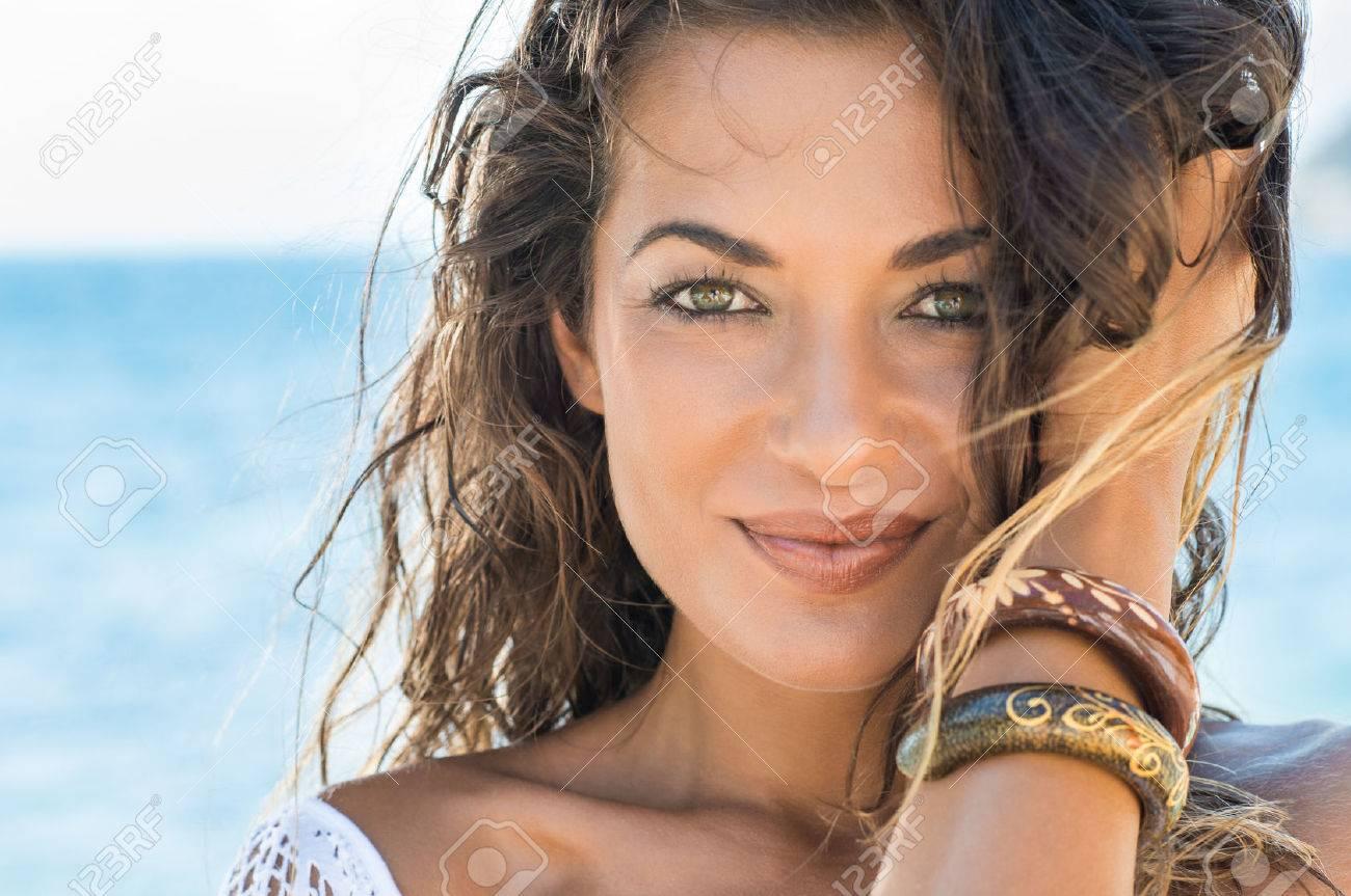 Close Up Of Carefree Girl Looking At Camera At Tropical Beach - 35534682