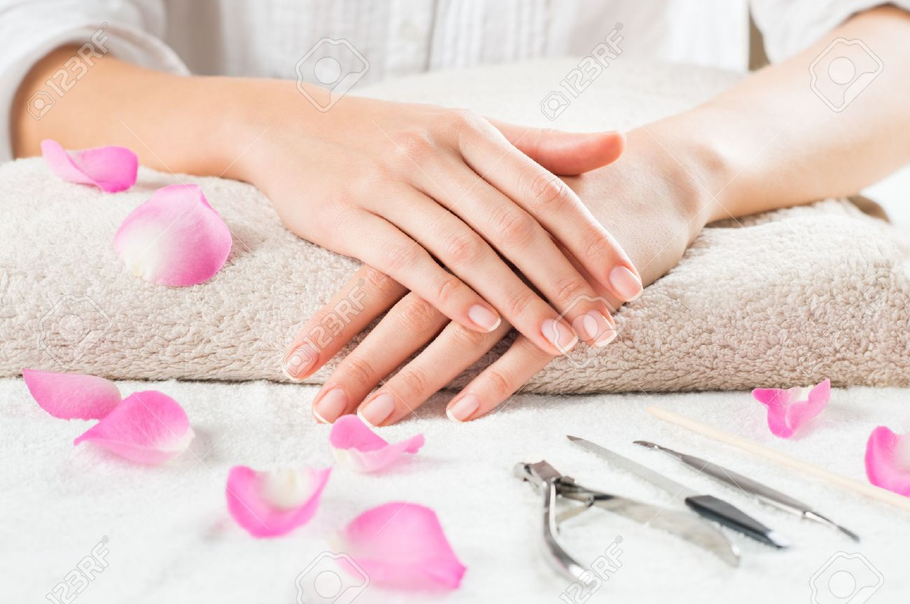 Closeup Shot Of Female Hands With French Manicure On A Towel.. Stock ...