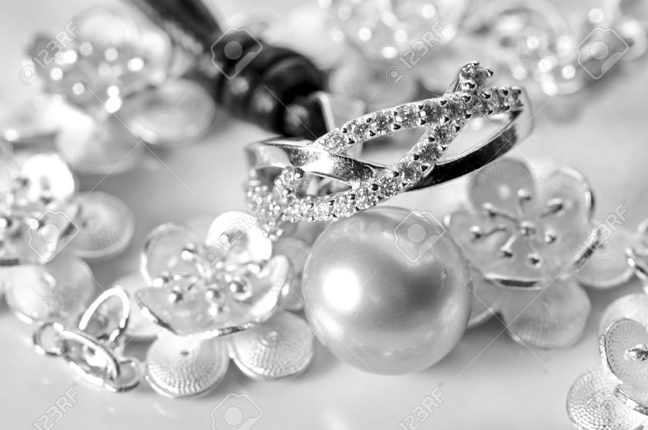 White Gold Jewelry With Ring Bracelet And A White Pearl Stock Photo