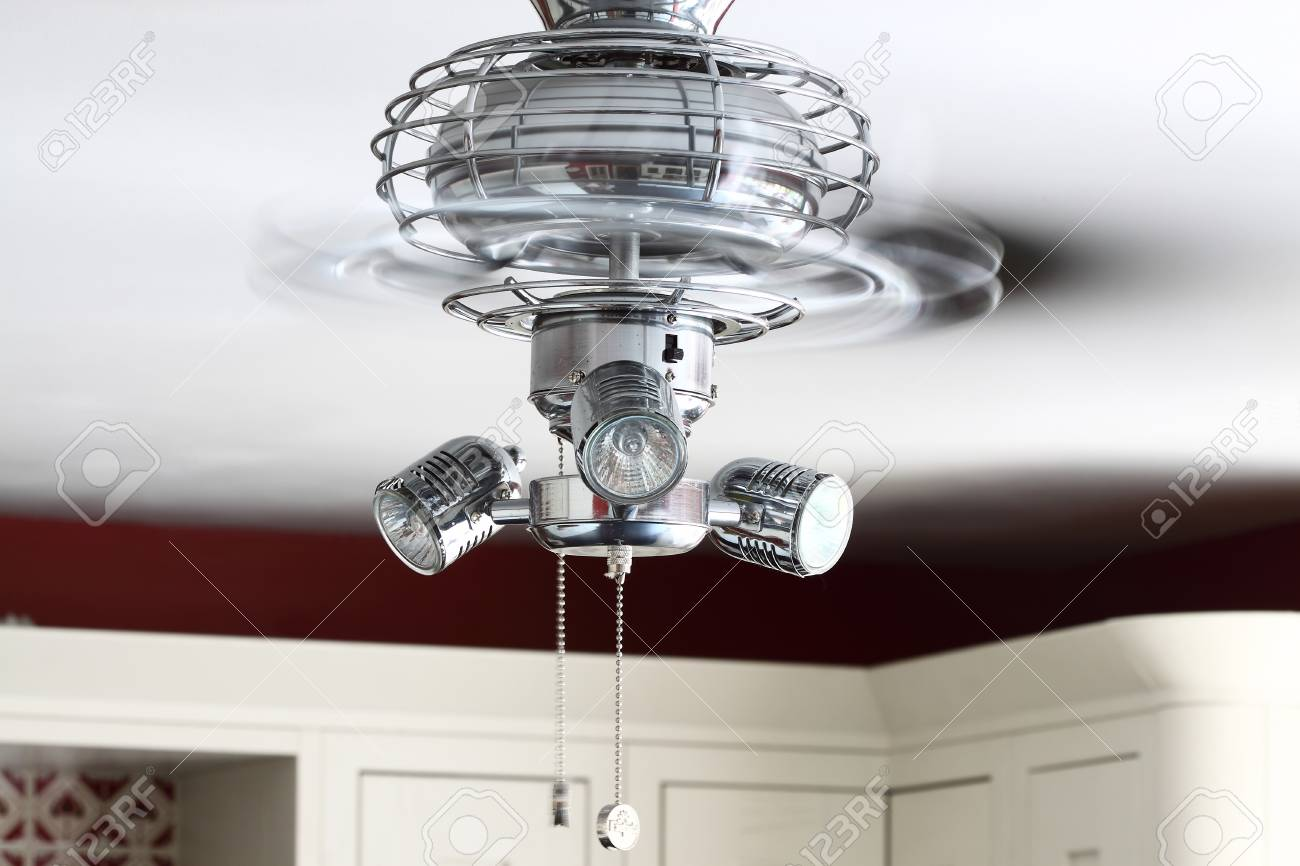 Electric ceiling fan light in a kitchen stock photo picture and electric ceiling fan light in a kitchen stock photo 75483740 aloadofball Choice Image