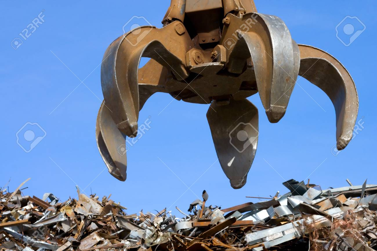 grubber up on metal heap Stock Photo - 5122729