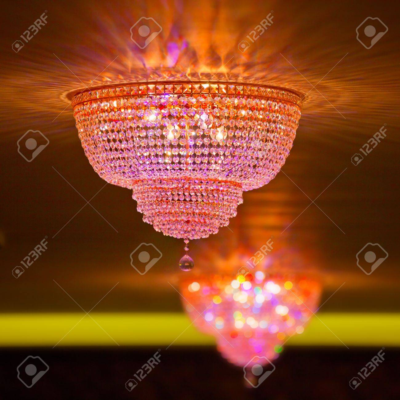 Two big elegant crystal chandeliers in the hotel shallow dof stock stock photo two big elegant crystal chandeliers in the hotel shallow dof arubaitofo Choice Image