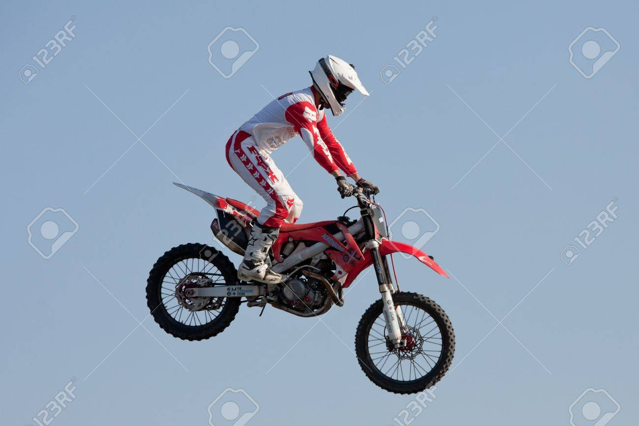 GALWAY, IRELAND - MAY 26: Dave Wiggins freestyle motocross rider jumps through the air during The  Extreme Stunt Show on May 26, 2012 in Galway, Ireland Stock Photo - 13887449
