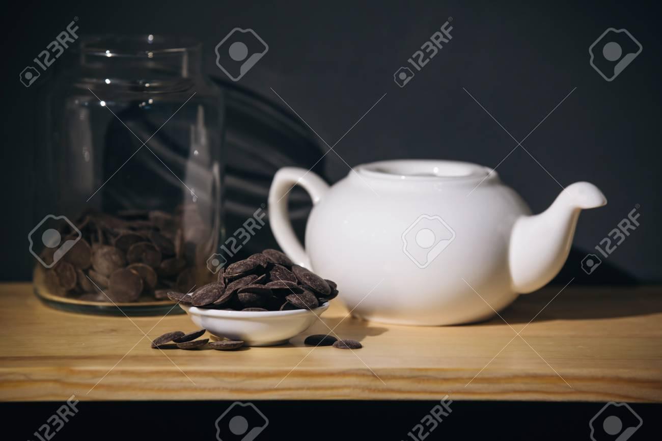 white ceramic teapot and chocolate - 99717210