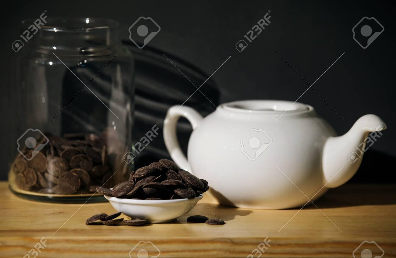 white ceramic teapot and chocolate - 99801233