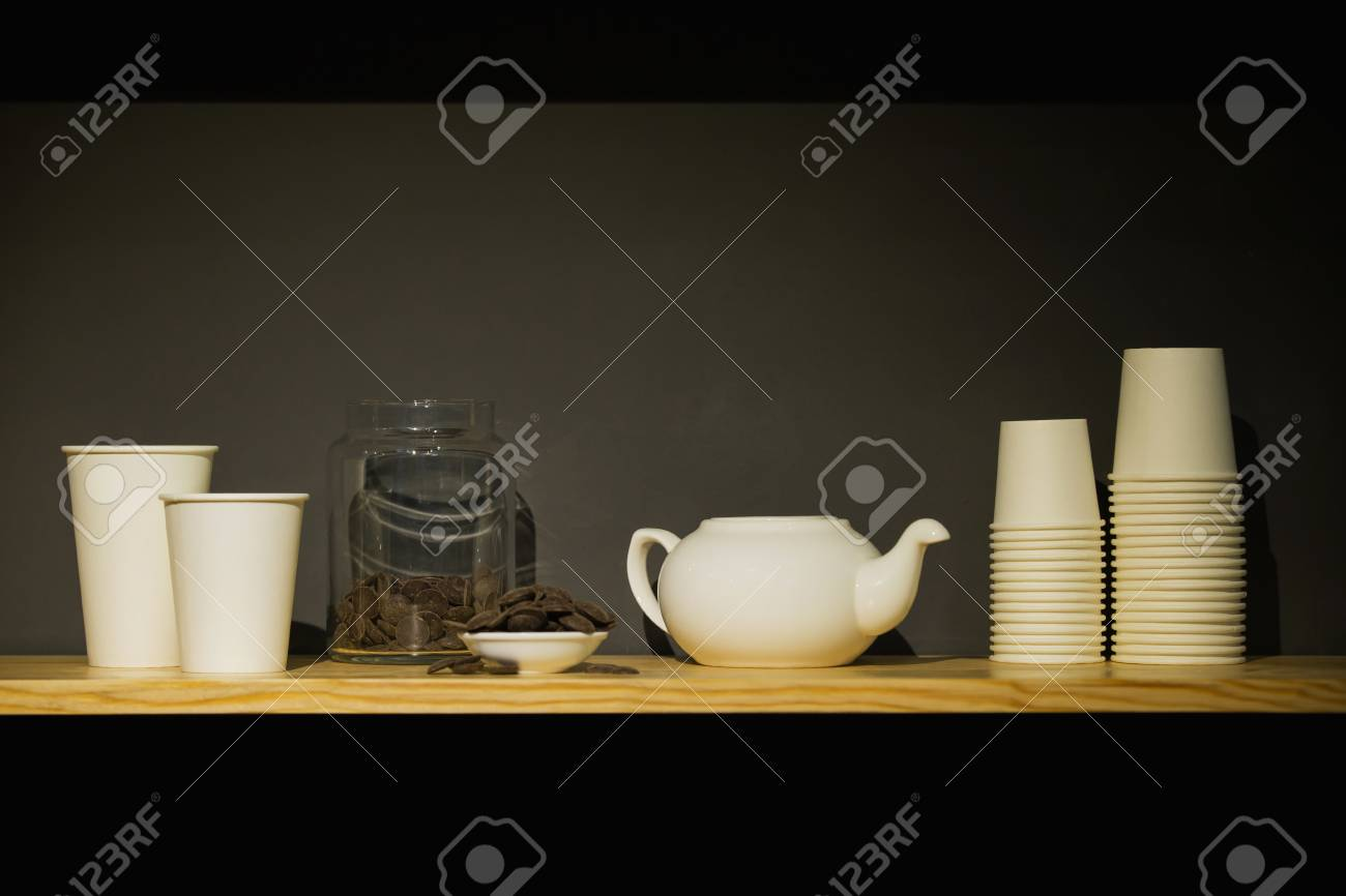 close-up of a set of coffee dishes, round crisp chocolate on a black background - 99735855