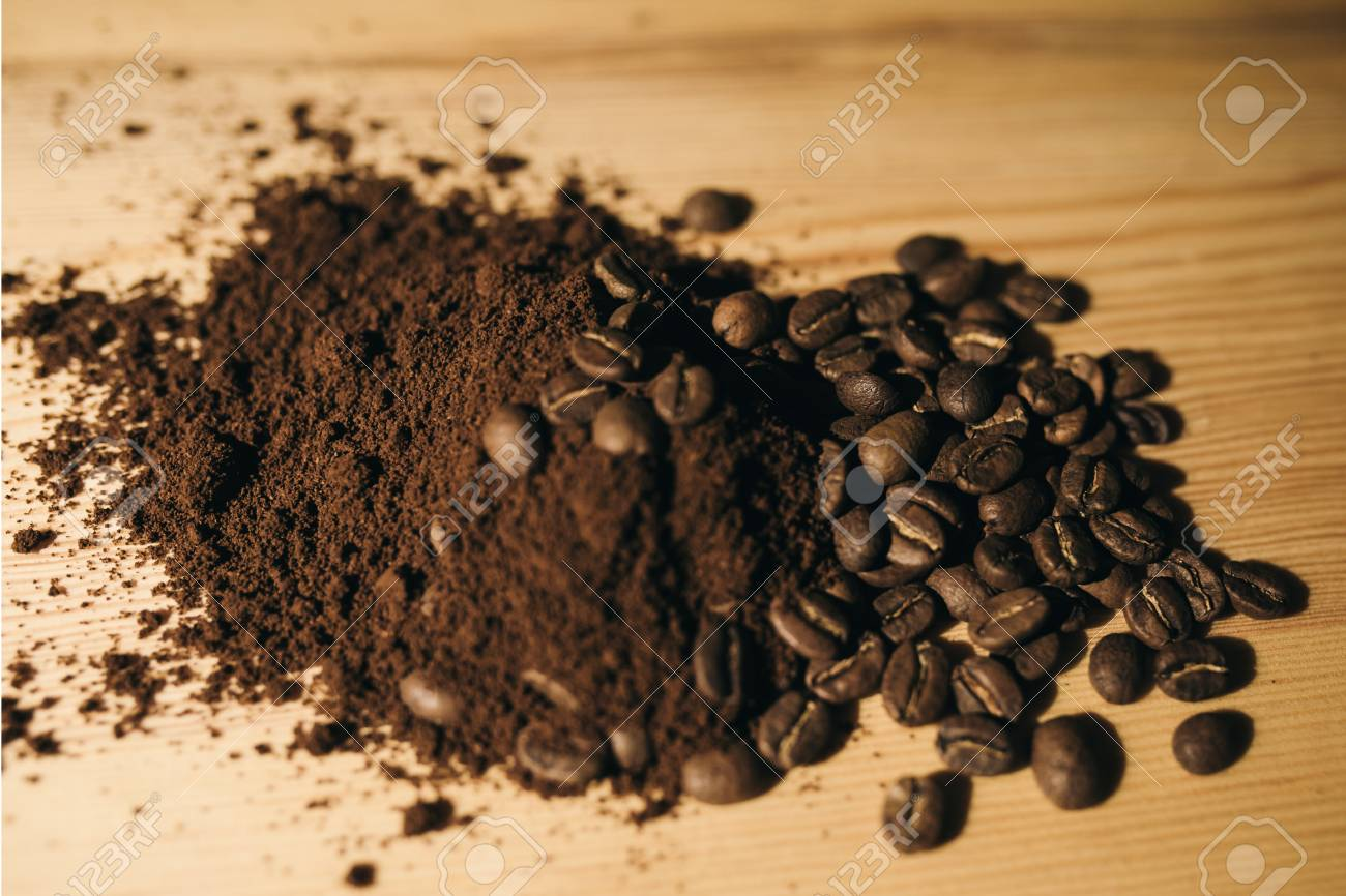 brown coffee grounds, located as a background - 99734822