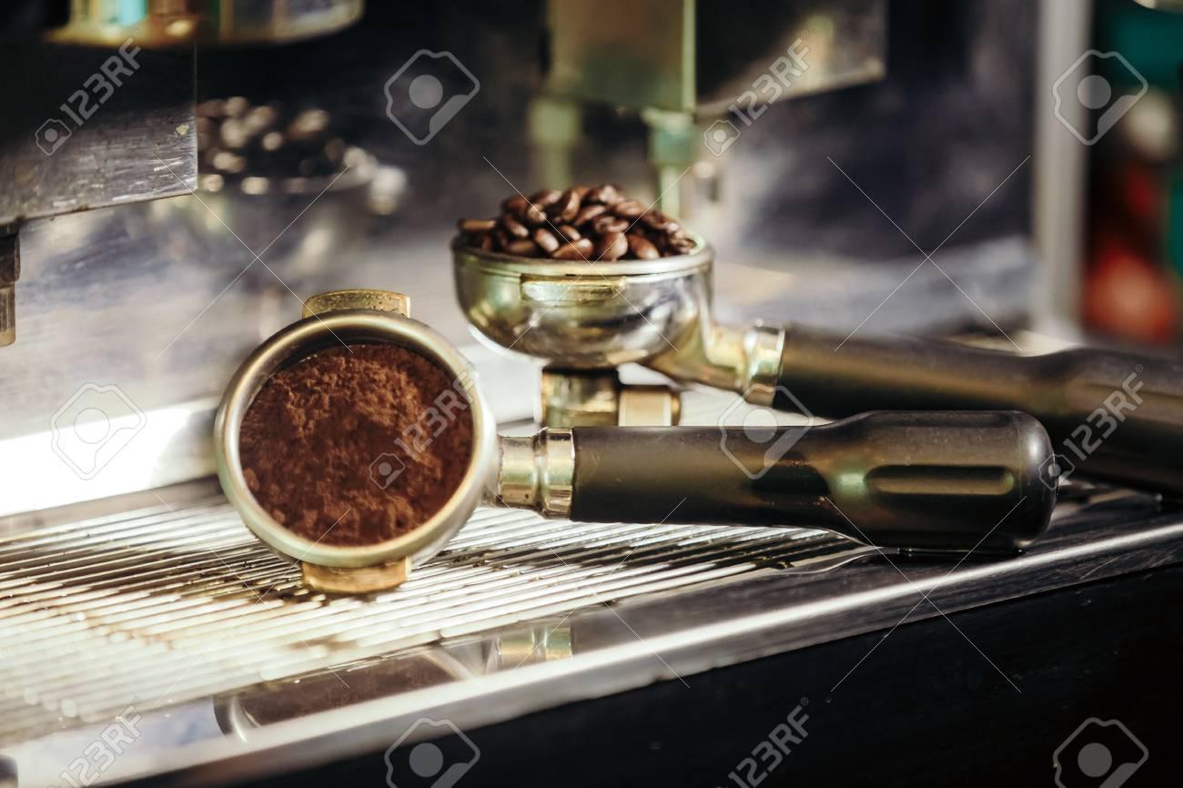 Barista roasting coffee beans grinder on coffee espresso machine - 99734823