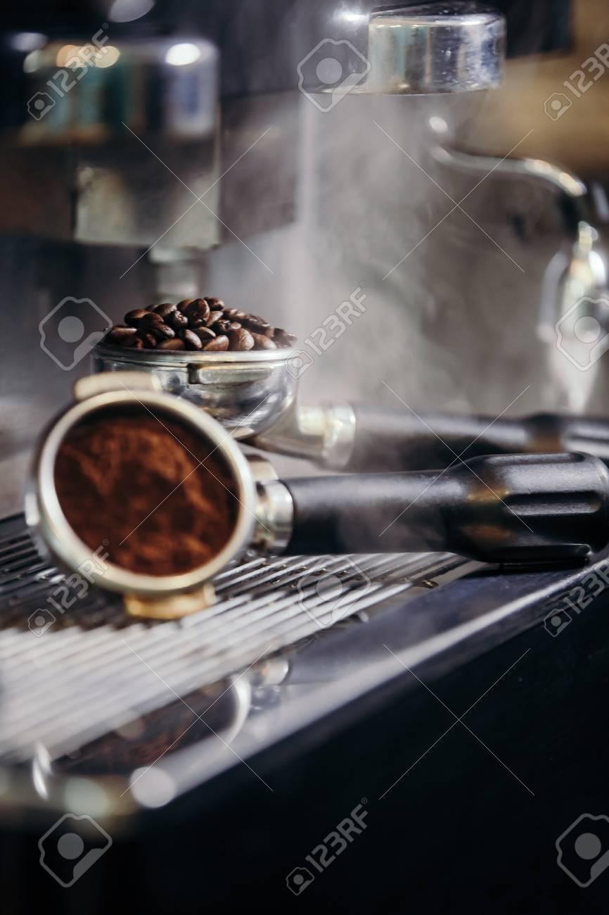 Barista roasting coffee beans grinder on coffee espresso machine - 99801246