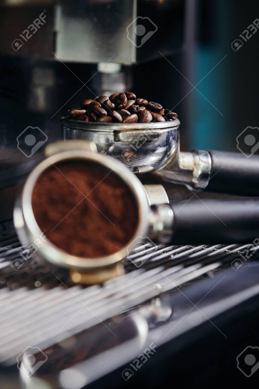 Barista roasting coffee beans grinder on coffee espresso machine - 99717221