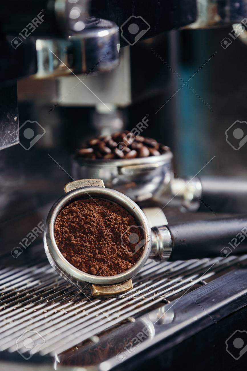 Barista roasting coffee beans grinder on coffee espresso machine - 99746573