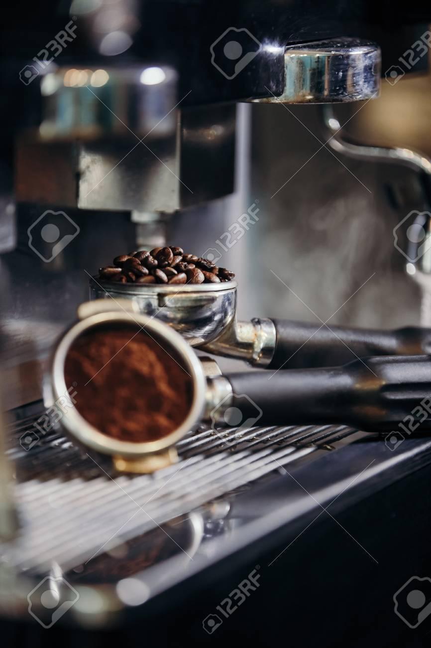 Barista roasting coffee beans grinder on coffee espresso machine - 99716583