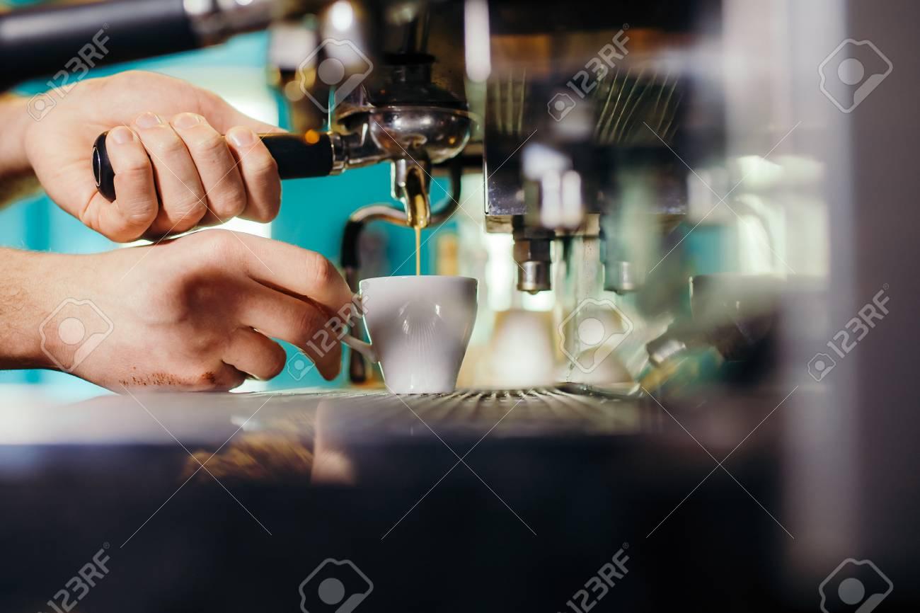 Man Preparing Coffee at Coffee Machine - 99739780