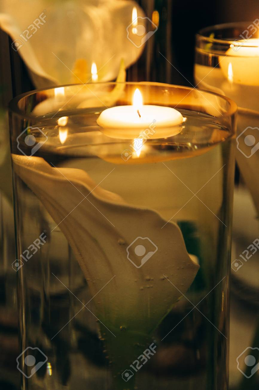 Vases with candles and lilies - 99854029