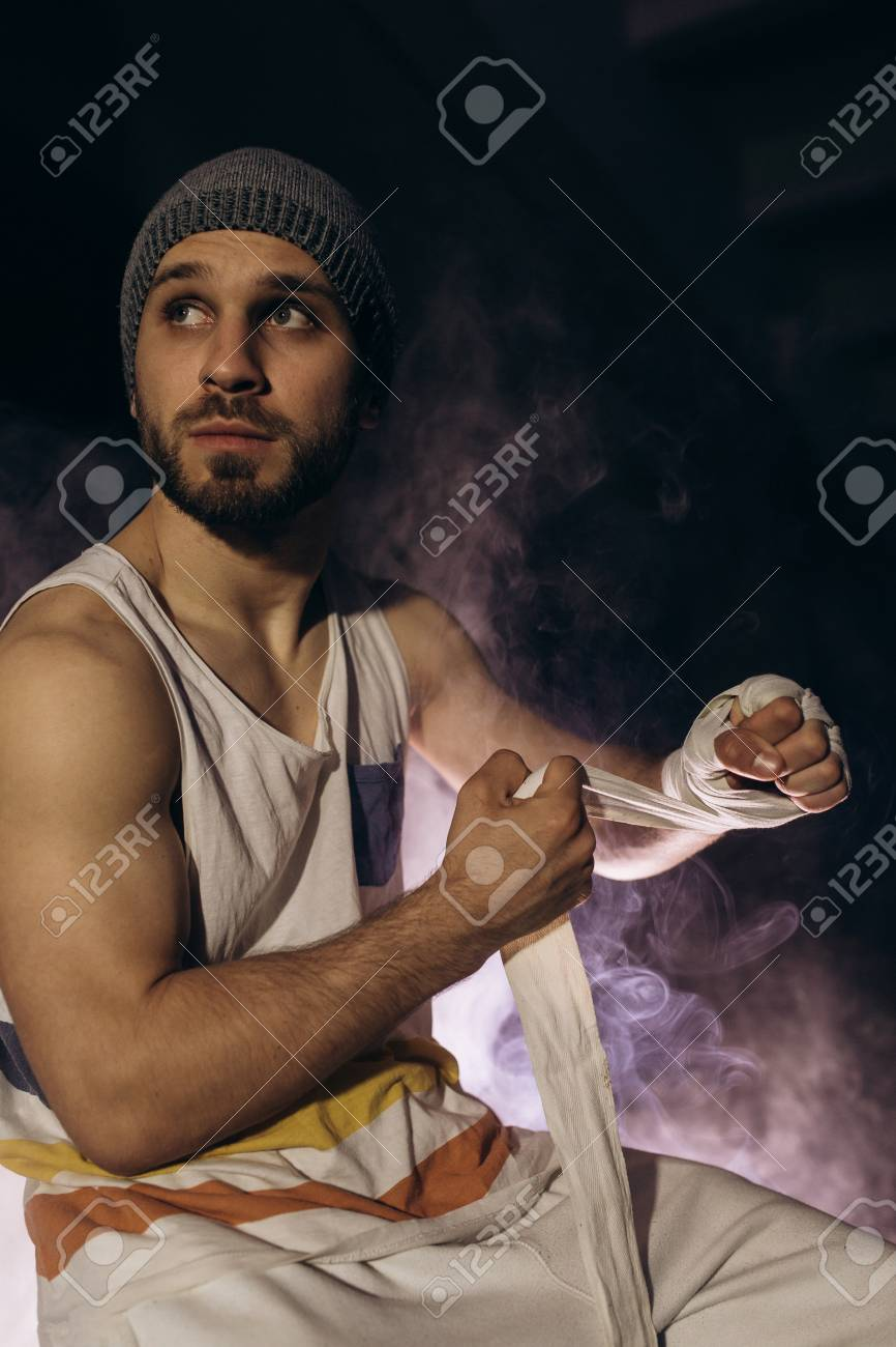 Model isolated on dark background in smoke. - 100992443