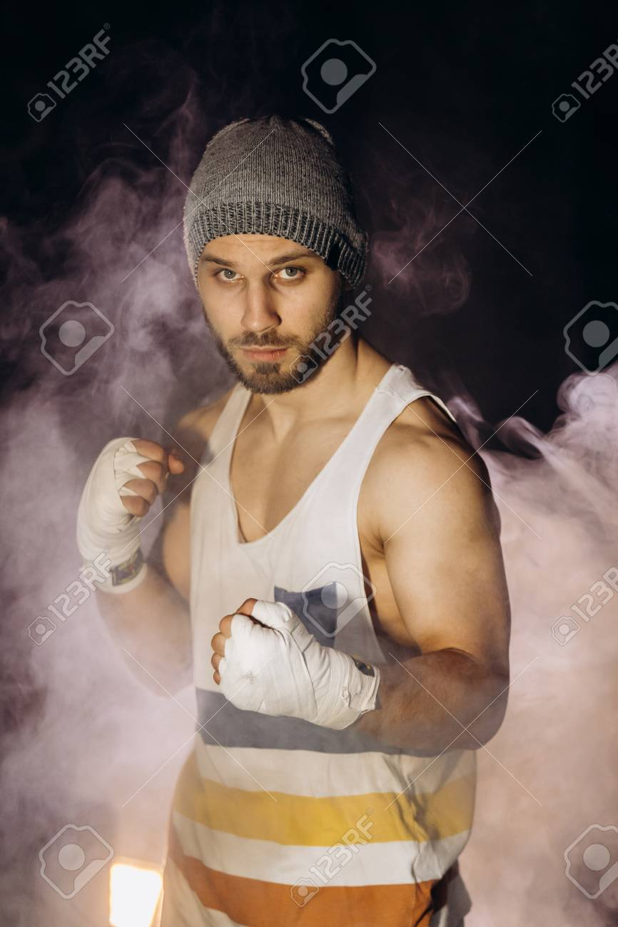 Young boxer fighting with bandaged fists - 102627364