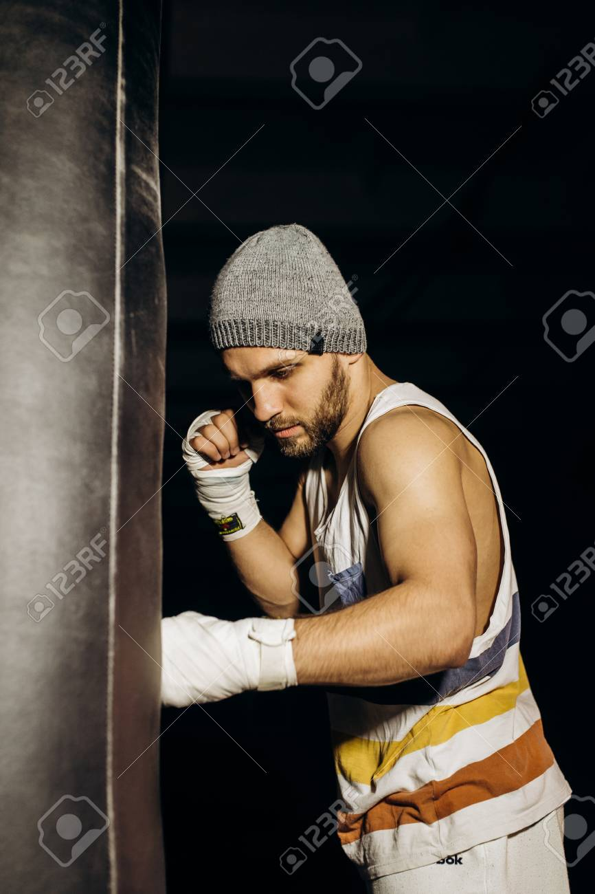 Young boxer fighting with bandaged fists - 103006723