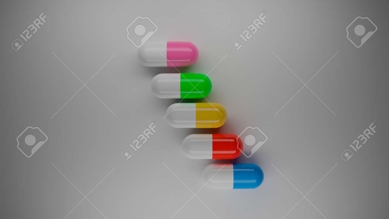 colored pills on white background - 158362251