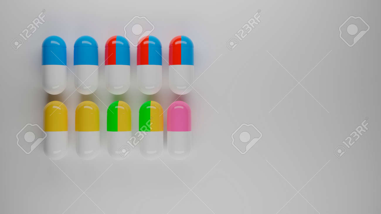 colored pills on white background - 158362252