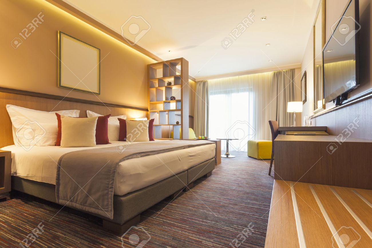 Modern Hotel Bedroom interior of a modern hotel bedroom stock photo, picture and