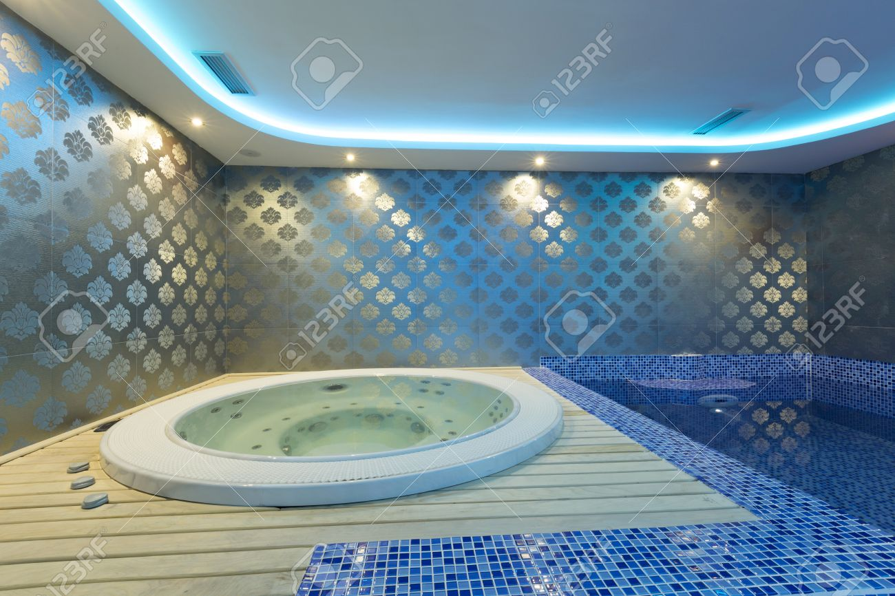 Indoors Jacuzzi And Pool With Colorful Lights At Spa Center Stock ...