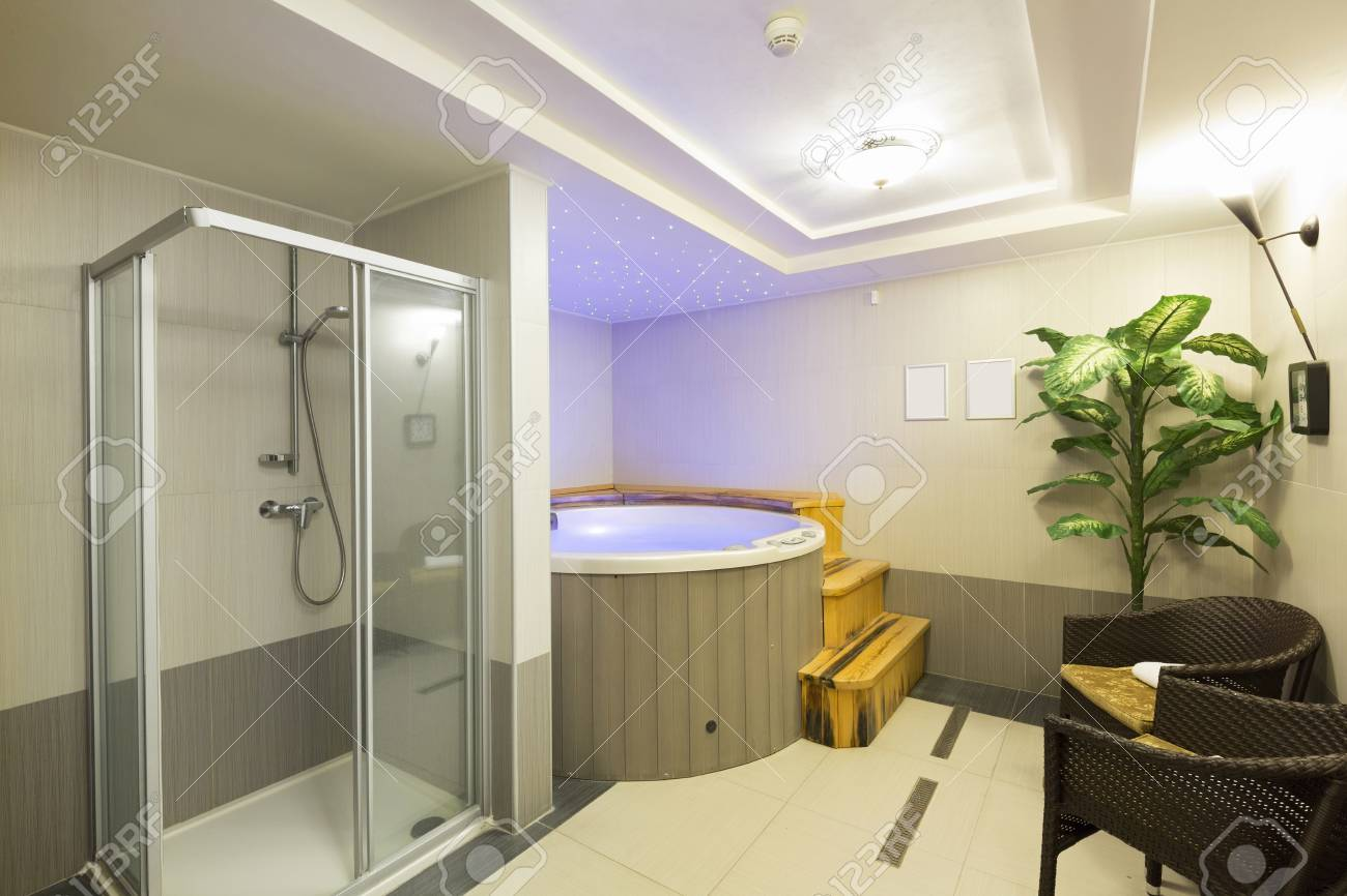 Jacuzzi Interior.Interior Of A Hotel Spa Center With Shower And Jacuzzi Bath