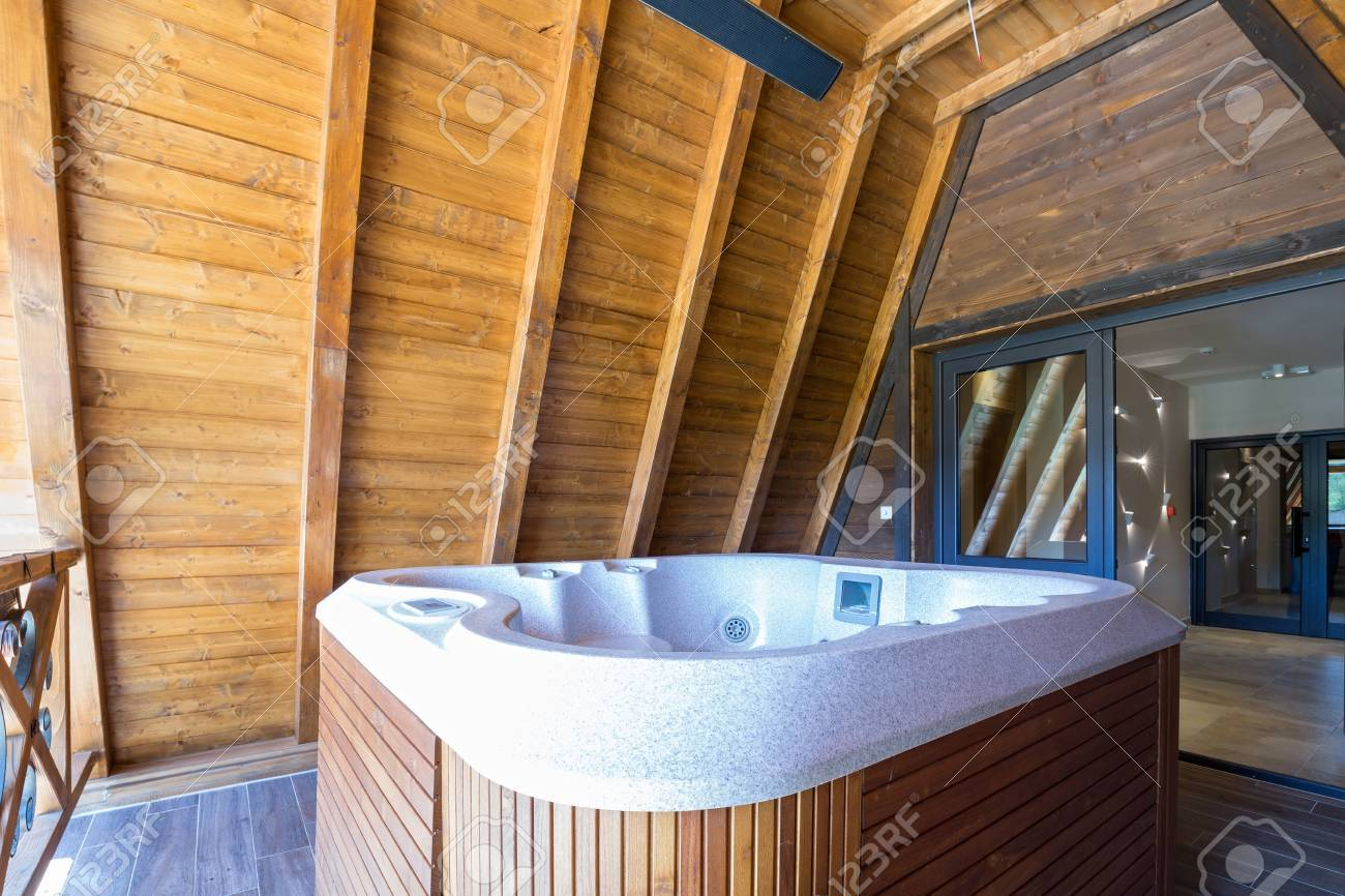 Hot Tub With Wooden Frame On Mountain Hotel Terace Stock Photo   64998419