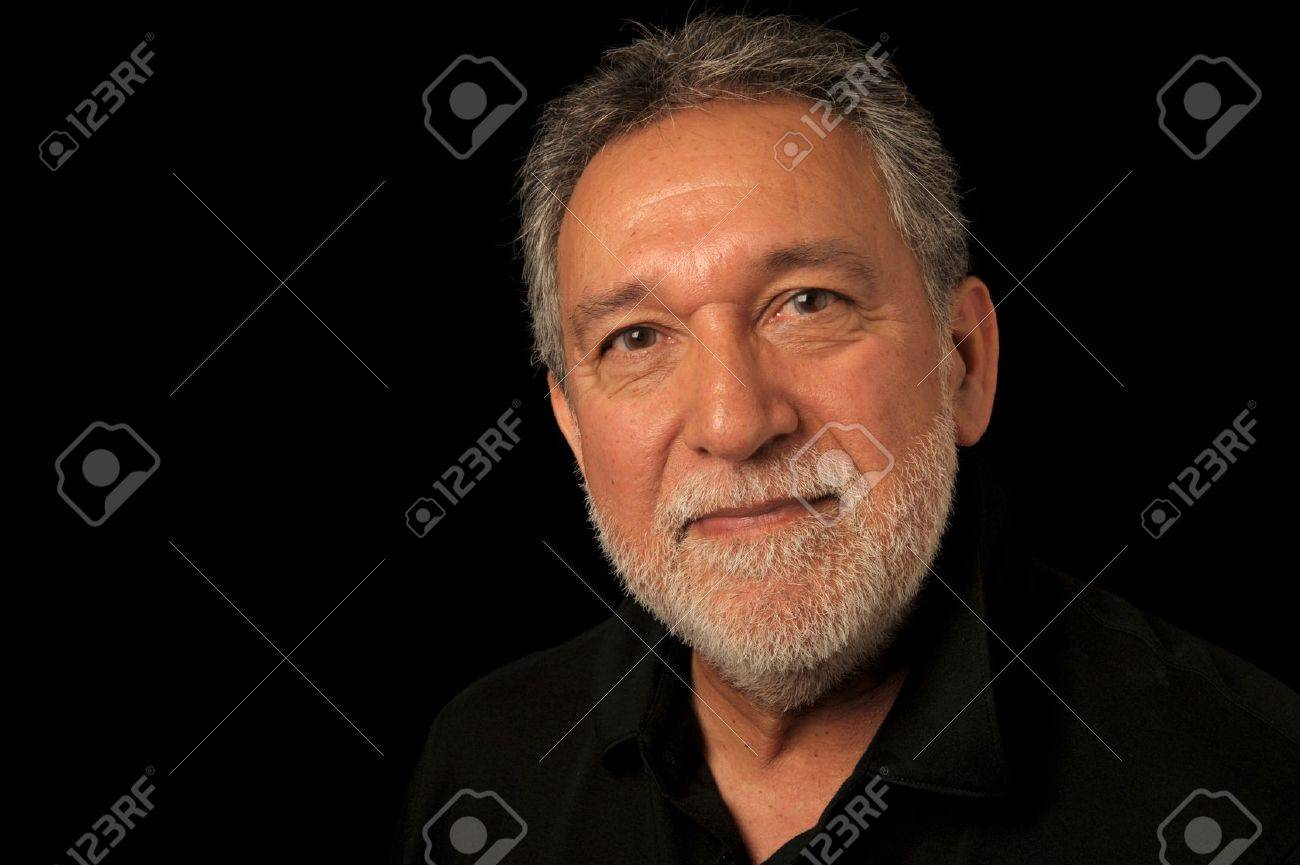 Very Nice Portrait of a Latino Man on Black Stock Photo - 11088922