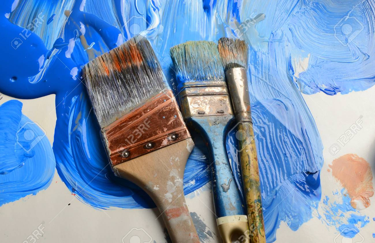 very nice 3 brushes a paper pallet and blue paint stock photo