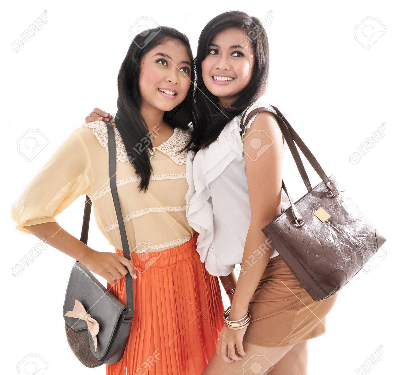 Stock Photo - Two girls best friend smiling and carrying bags 5f79ffd13007