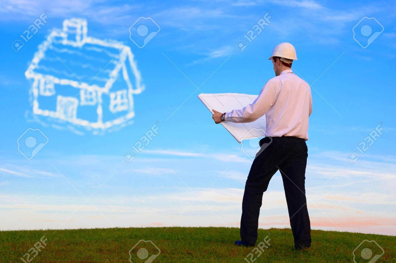 Man with plan and cloud-house standing on a meadow Stock Photo - 11179459