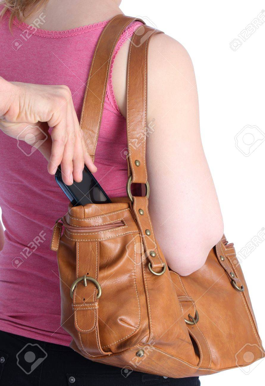 Pickpocketing a mobile out of a handbag of a woman Stock Photo - 12545342