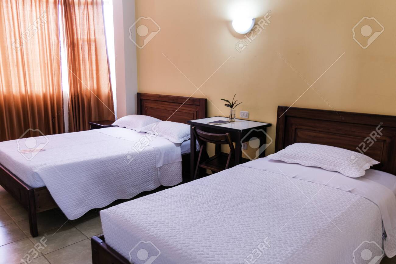 Hotel Room With Twin Beds Of White Sheets A Small Table With Stock Photo Picture And Royalty Free Image Image 134804643
