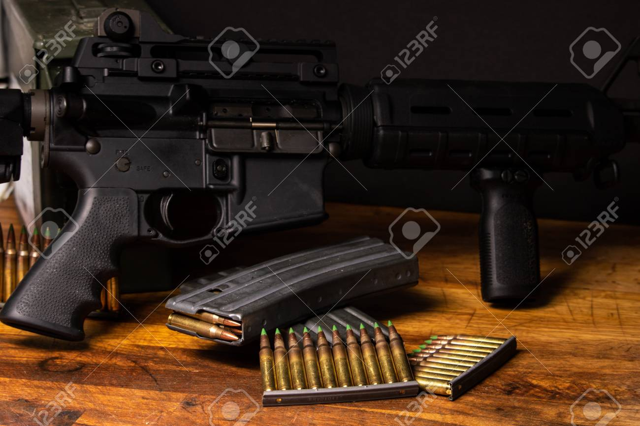 Dark setting with an AR-15 with 5.56 ammunition and magazines - 100071680