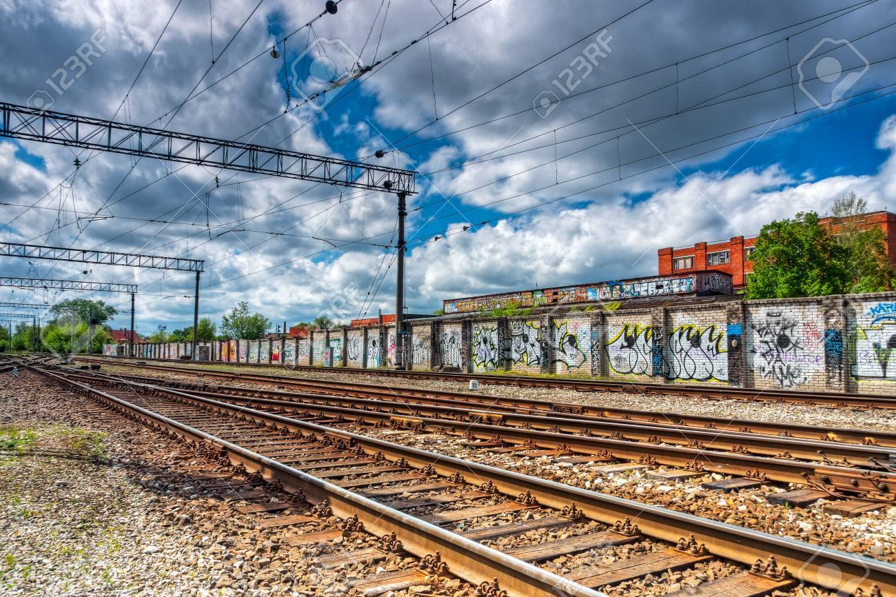 Background image rails - Railway Slide Rails And A Wall Full Of Paintings In Background Stock Photo 17950407