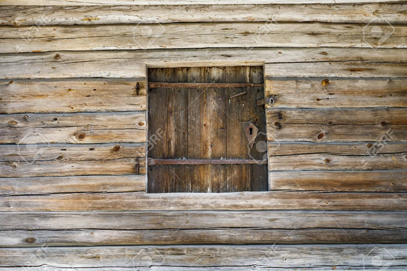 Timber made hatch in a wooden wall