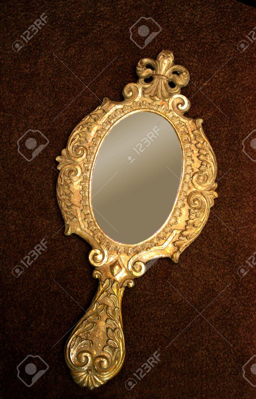 Old brass hand-mirror - 11697122