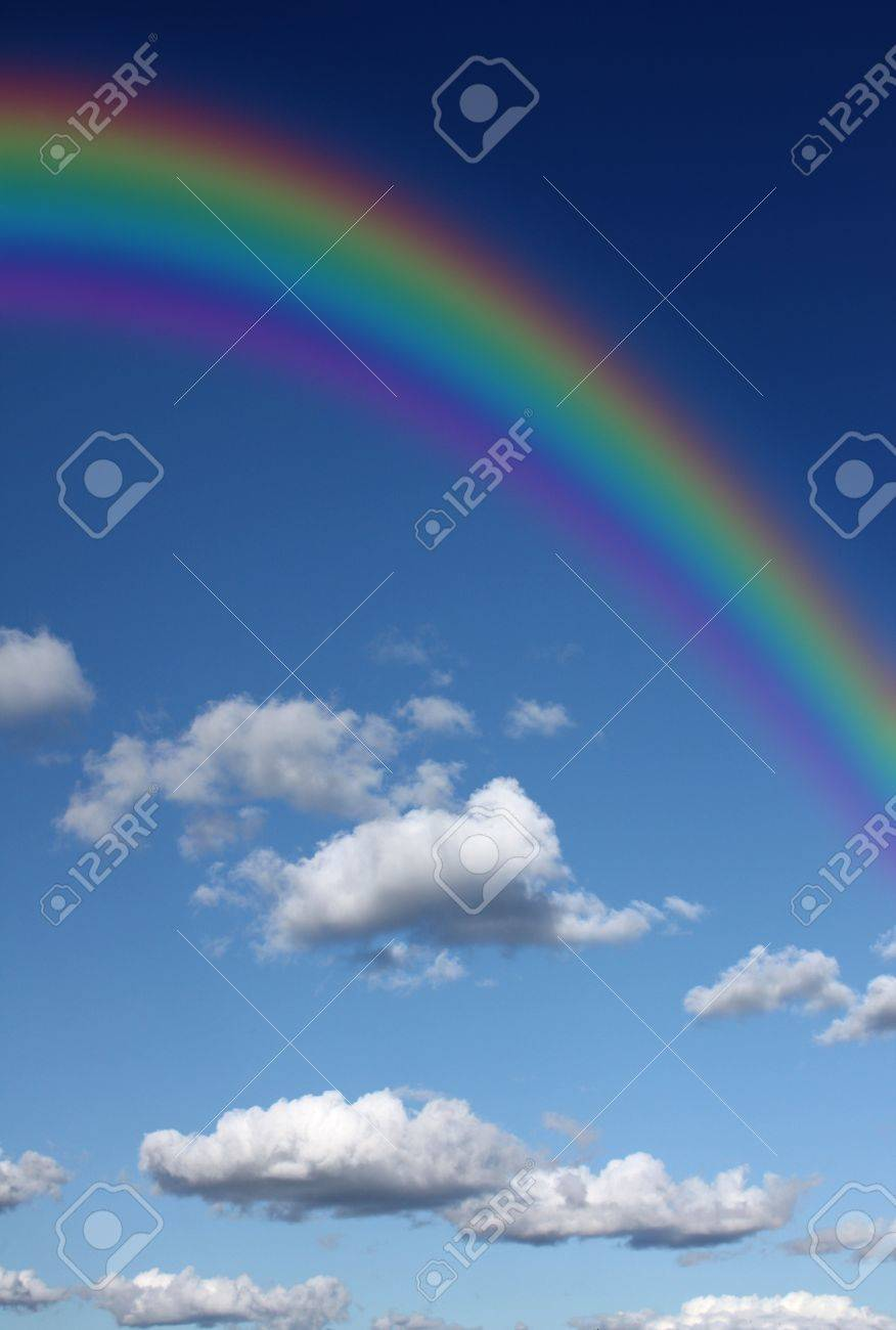Rainbow in the sky with clouds Stock Photo - 11697088