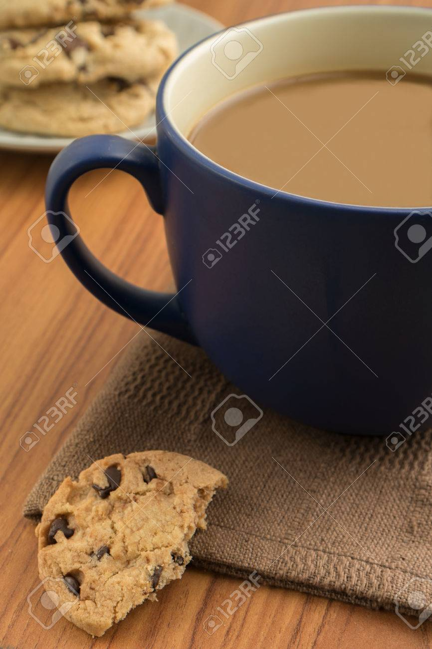 Chocolate chip cookies and a coffee mug Stock Photo - 24258301