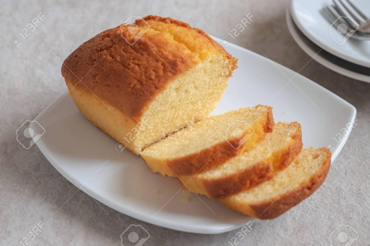 Butter cake loaf or pound cake sliced on plate - 141419992