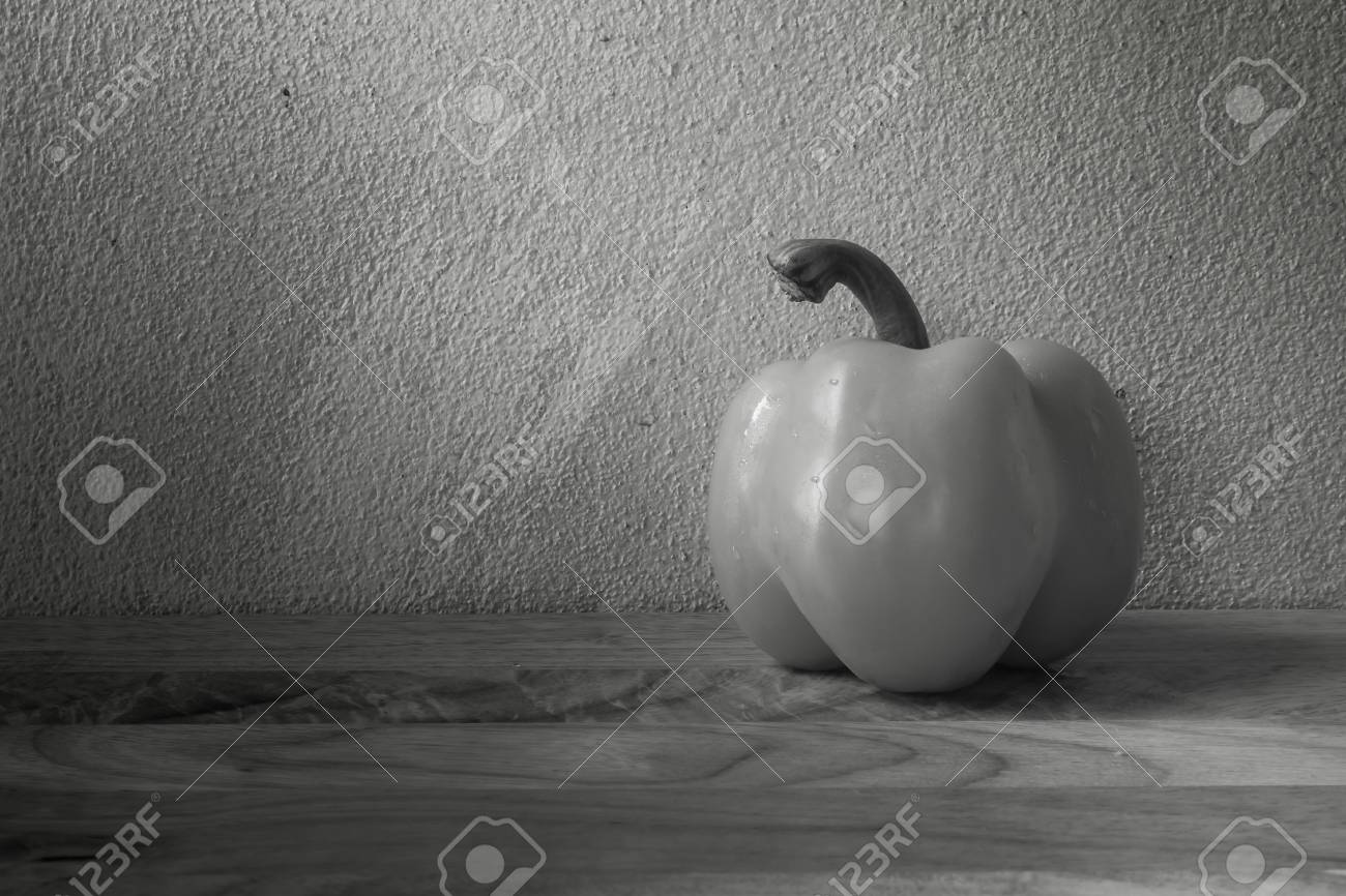 Vintage still life with bell pepper and grunge background on black and white stock photo