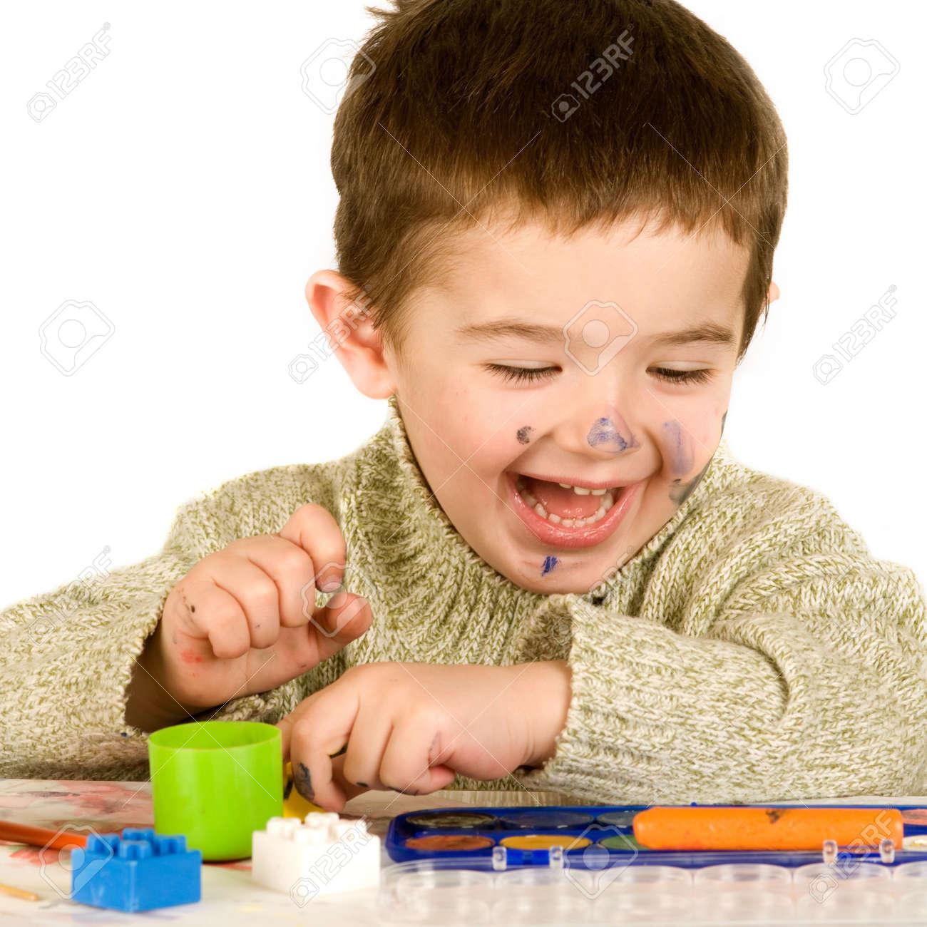 Beautiful young boy enjoying his game. Stock Photo - 4444792