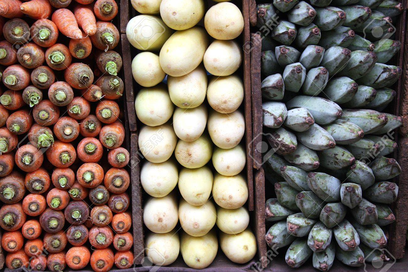 A display of carrots, white aubergines and green bananas for sale at a Sri Lankan market. Stock Photo - 10308944