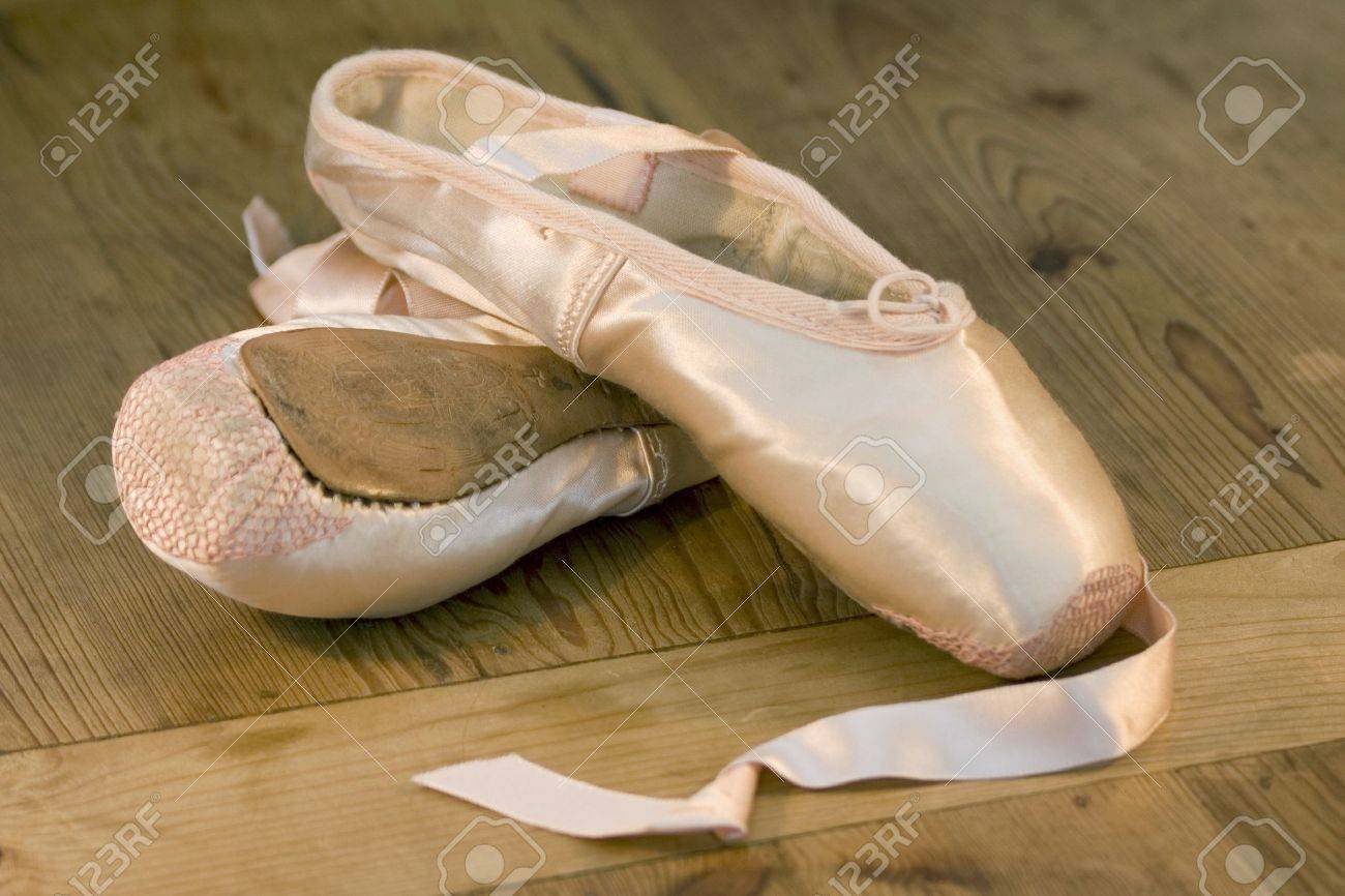 A pair of discarded ballet shoes on wooden dance studio floor Stock Photo - 10837736