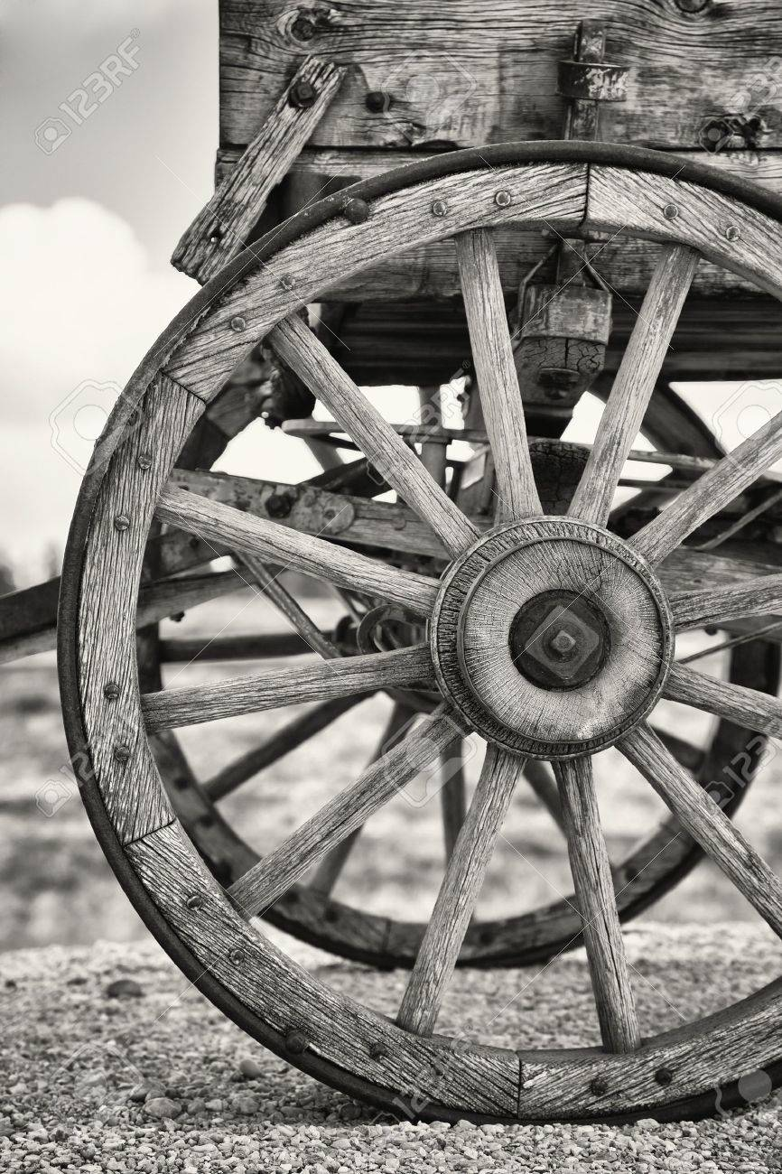 Closeup of the wheels of an old Wagon, Utah, USA. Black and white with slight sepia toning. Stock Photo - 17217258